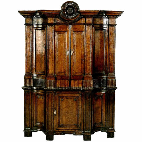 Exceptional oak cabinet with concave-shaped side sections and carved sunflower. view 1