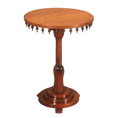 A 19th century Anglo-Indian teak tilt-top table. view 1