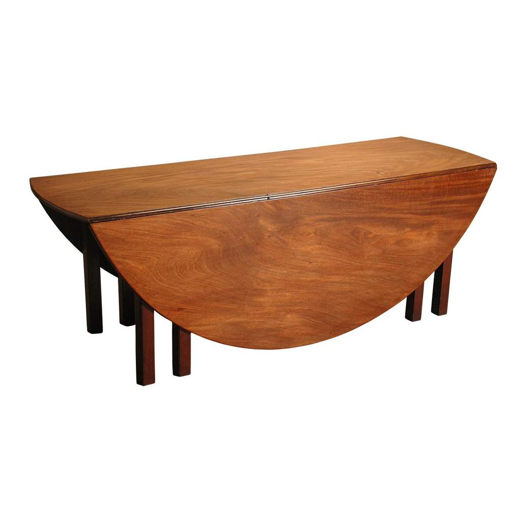 An antique Irish mahogany wake table with highly figured top. view 1