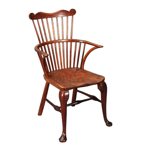 A 19th century comb-back Windsor armchair with cabriole front legs. view 1