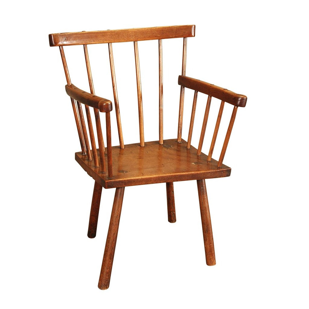 A  19th century simple Windsor chair in ash with a sycamore seat. view 1