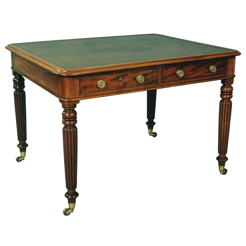 A two-sided 19th century writing table on tapered, reeded legs ending in brass cup casters. view 1