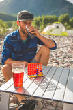 Cheers to playing Connect Four on the beach.