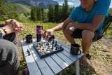 Playing Outside Inside Folding Magnetic Chess/ Checkers at the campground