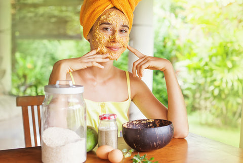 Girl using natural face mask - CBD hemp extract for skin care blog by O2 Living makers of organic cold-pressed fruit and vegetable Living Juice