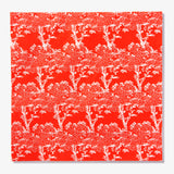Orange/red dinner napkin with white cherry tree pattern