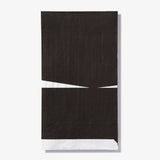 White guest towel napkin with black abstract pattern
