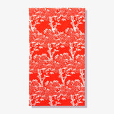 Orange/red guest towel napkin with white cherry tree pattern