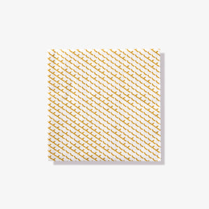 White cocktail napkin with gold abstract pattern