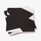 White dinner napkin with black abstract pattern