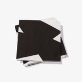 White cocktail napkin with black abstract pattern
