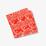Orange/red cocktail napkin with white cherry tree pattern
