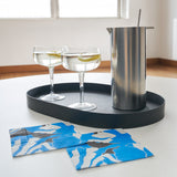Blue, gray, white and black cocktail napkin with floral pattern