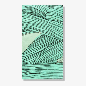 Green, black and off-white guest towel napkin with abstract pattern