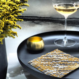 Gold, black and white cocktail napkin with abstract pattern