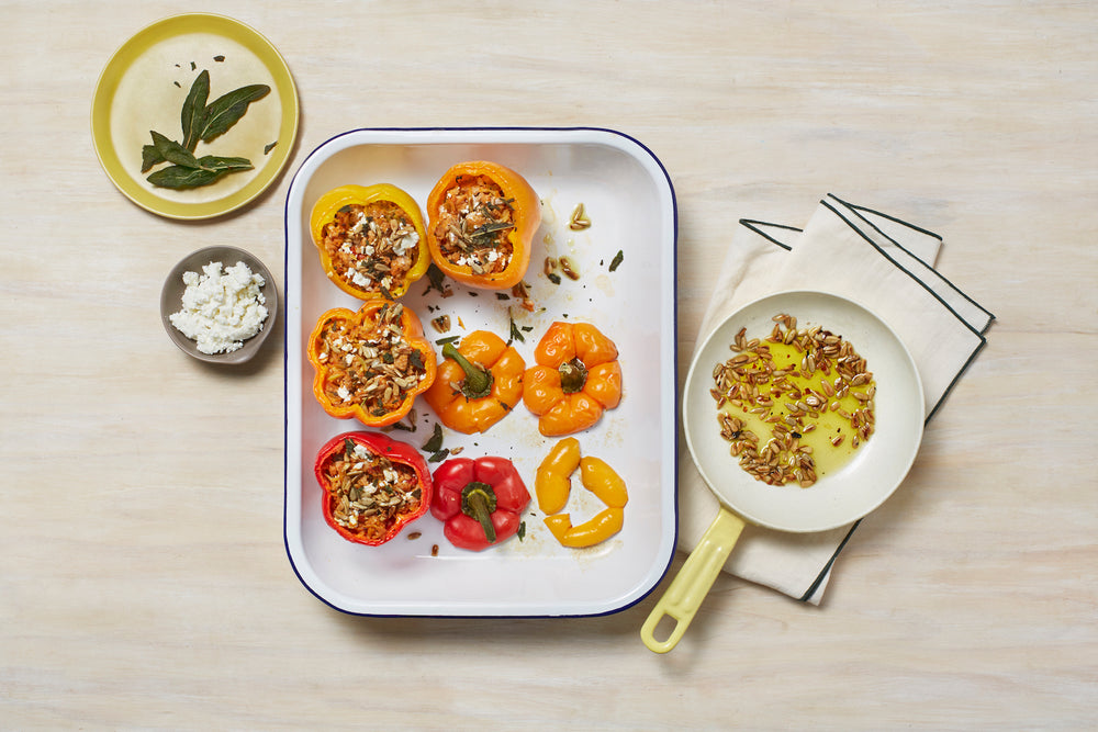 Banza rice stuffed peppers with feta, pepitas, and chili-sage oil