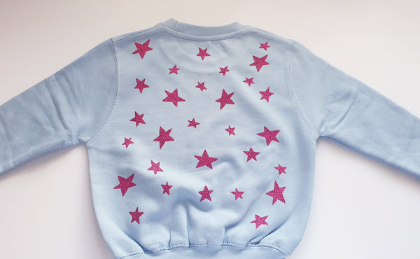 It's all about, star back sweater
