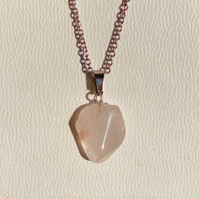 Natural rose quartz gemstone   Stainless Steel cable chain with lobster claw fastening   Pendant size is 2cmx2xm approx.   Chain is 45cm in length   Each gemstone is unique therefore there are variations in shape, colour and size