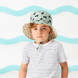 boy wearing Acorn Kids Gorilla Bucket Hat