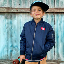 boy wearing Alphabet Soup Quilted Bomber Jacket
