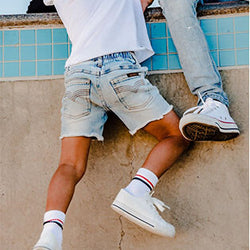 boy wearing Beau Hudson Blue Denim Jeg Shorts