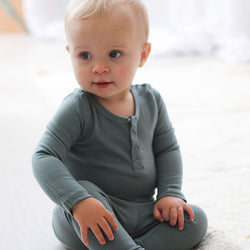 baby boy wearing Burrow & Be Henley Merino Bodysuit (Storm)