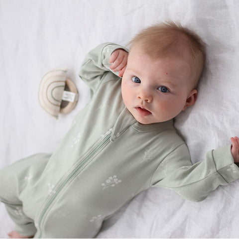baby wearing Burrow & Be Zipsuit (Sprig)