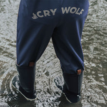 boy in Crywolf Play Rain Overalls Indigo