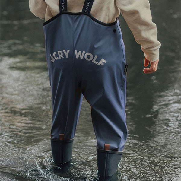 boy wearing Crywolf Play Rain Overalls Indigo