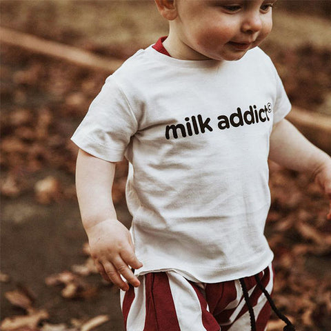 baby boy wearing Milk Addict Logo tee Shirt