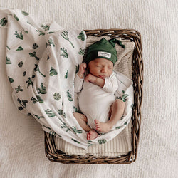 baby boy wrapped in Snuggle Hunny Kids Cactus | Organic Muslin Wrap