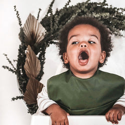 boy wearing Olive | Snuggle Bib Waterproof