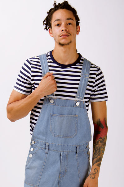 Cargo pocket pale wash bib-overall shorts paired with hooped t-shirt.