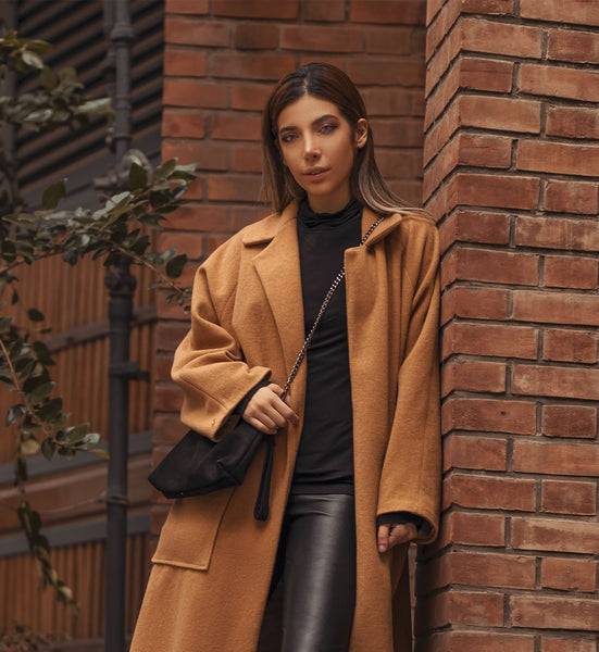 Brown Coat - Ali Pazani, paired with black leather trousers.