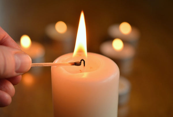 Lighting a candle.