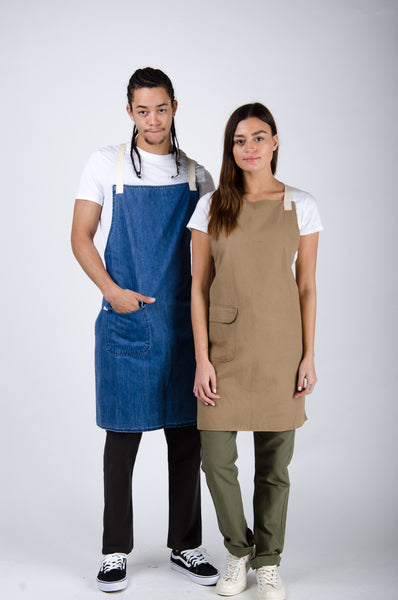 Man and woman wearing elegant, practical aprons from USKEES USA.
