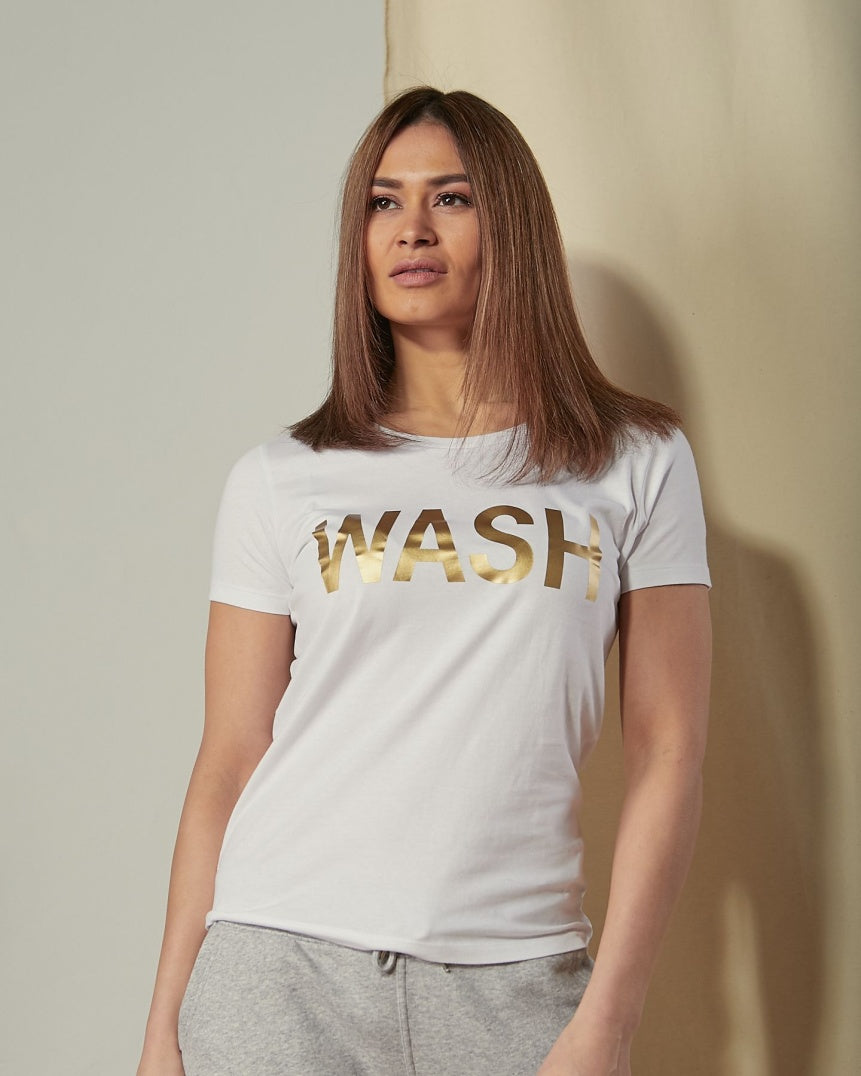 Wearing white 'WASH' branded t-shirt and gray pants.