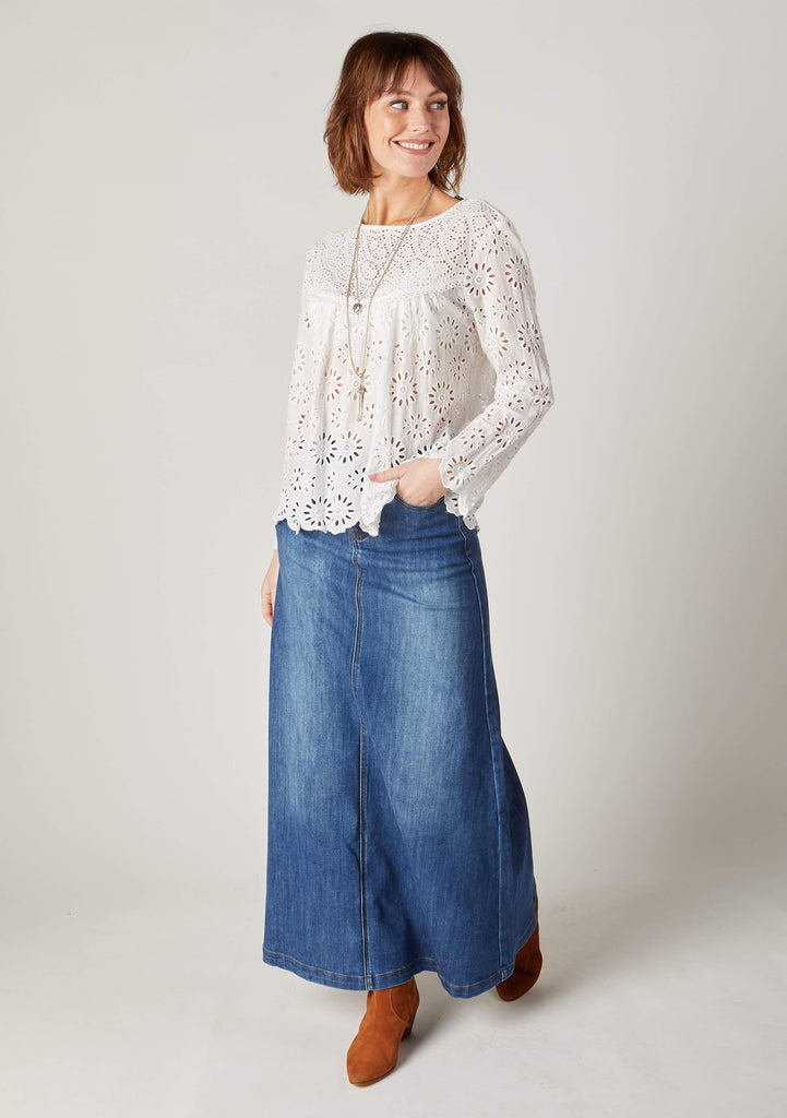 Full-length front pose of ladies ankle length stonewash jean skirt