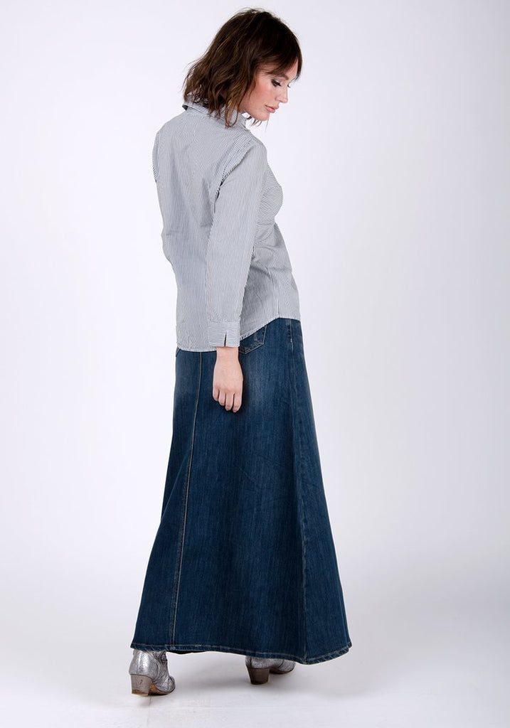 Full side-rear pose wearing Ramona-style denim skirt with abrasion detail.