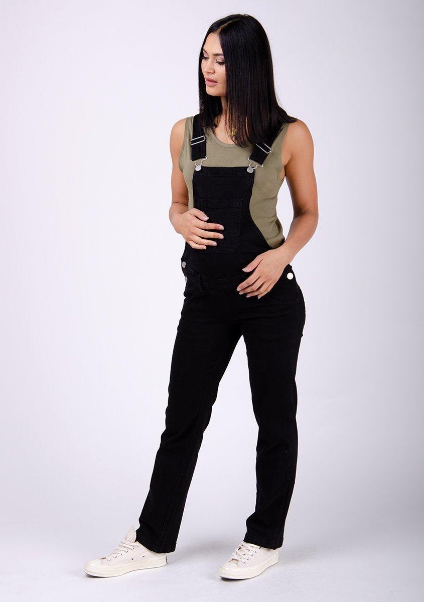 Full frontal pose facing to her right, dungarees designed for mums-to-be.