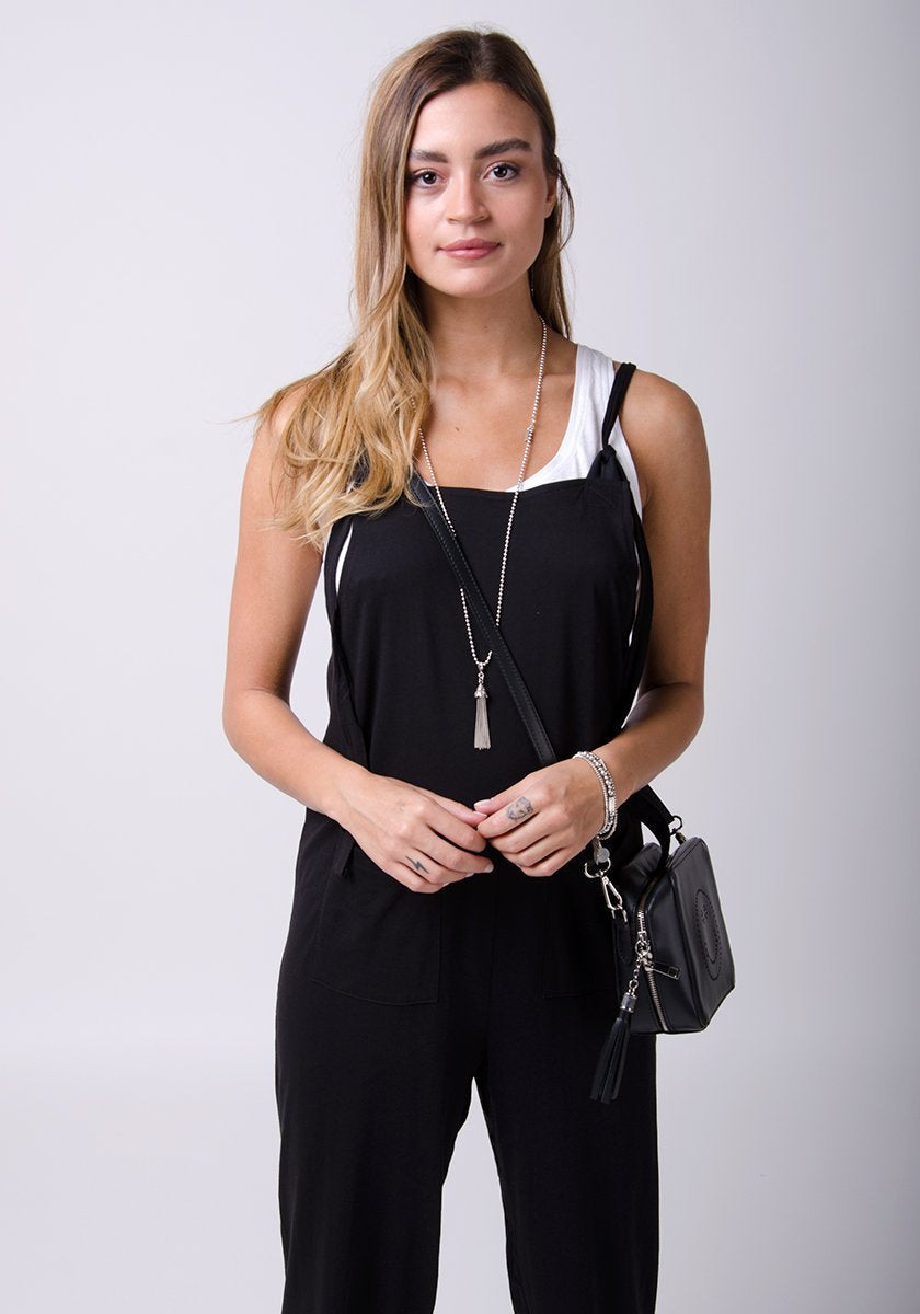 Half frontal pose wearing Mabel-style pale black jersey jumpsuit.
