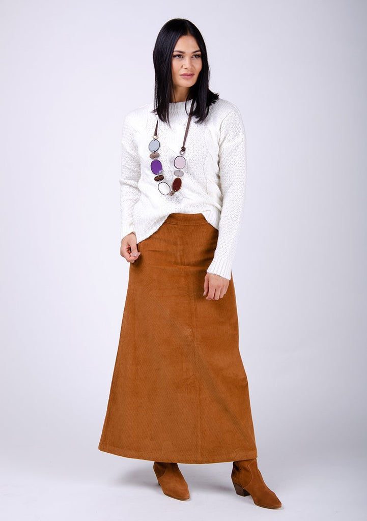 Full-frontal pose looking to her left wearing versatile Lottie long brown cord skirt.