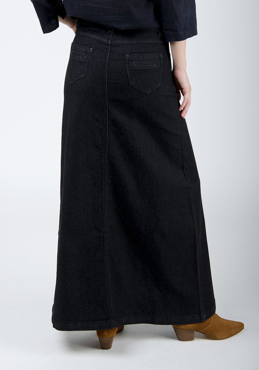 Close-up rear pose of cotton-polyester mix, long black denim skirt with no back split.
