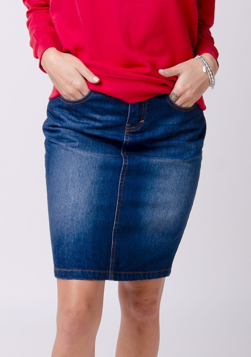 Half-front pose focussing on denim texture of knee length denim skirt.