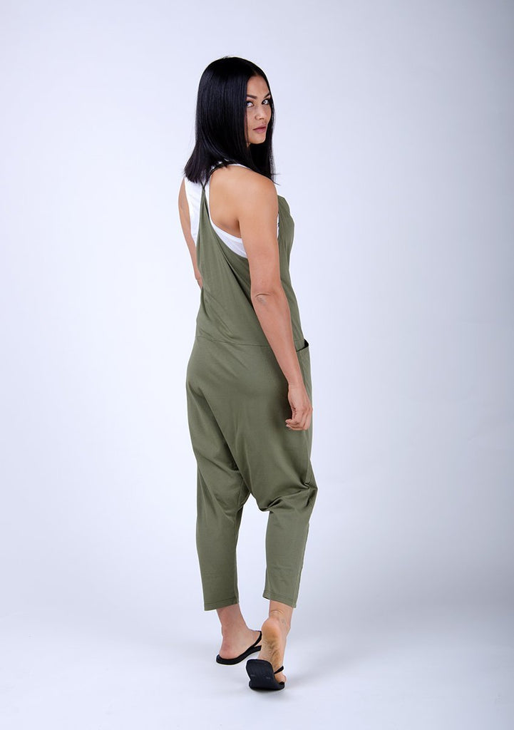 Full side pose showing harem pants width and adjustable straps.