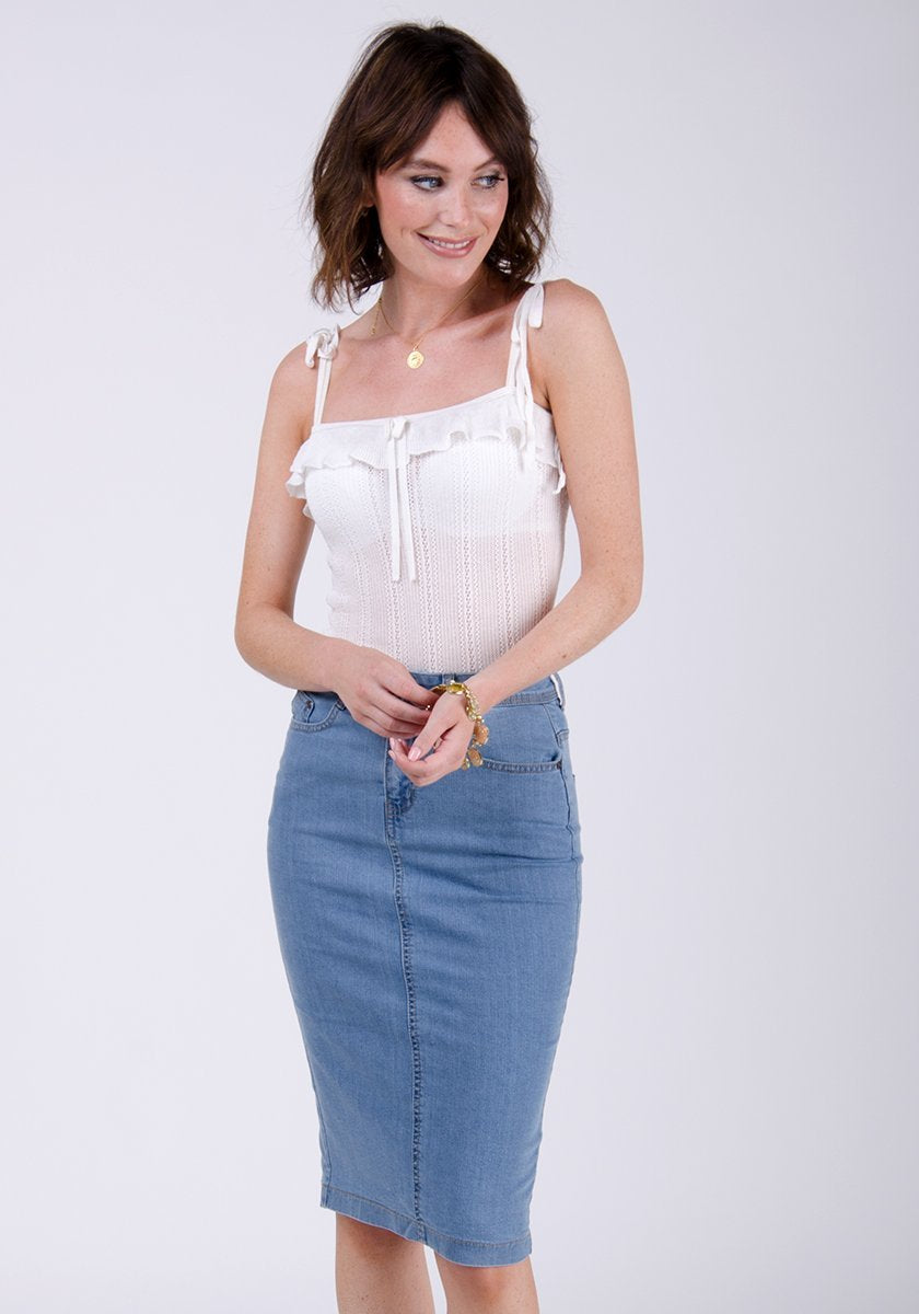 Two-thirds frontal pose wearing Kay style pale wash denim skirt.
