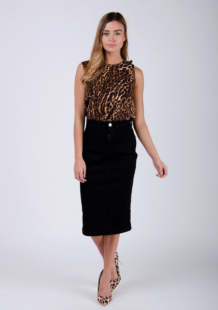 Full frontal pose wearing Cynthia style, black midi-skirt and animal print top.