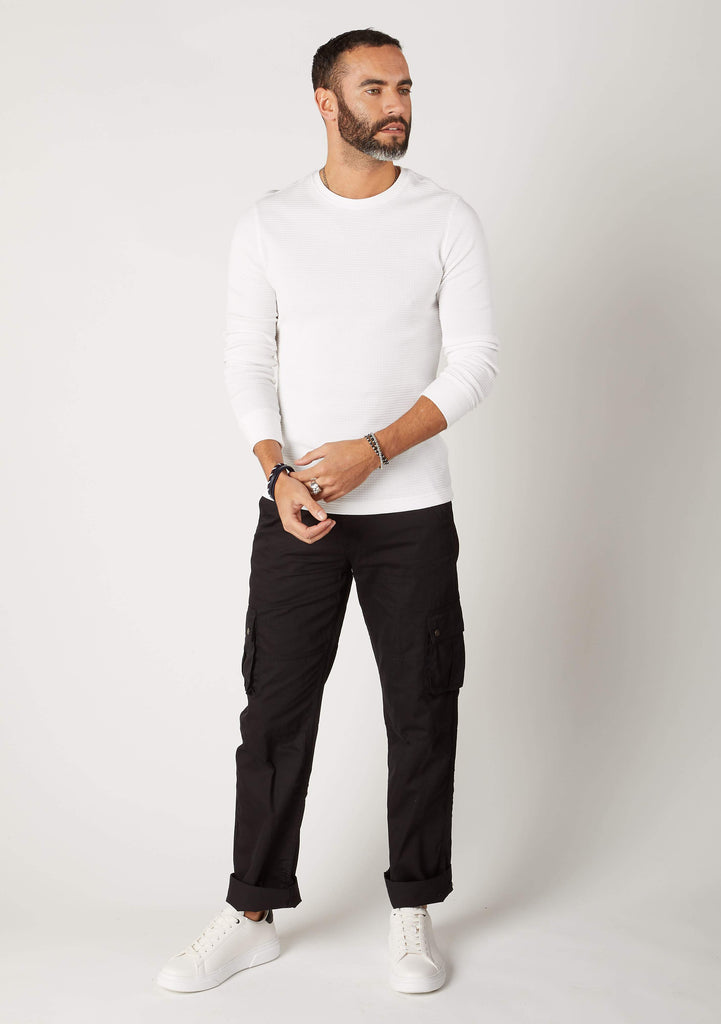 Front full length pose of Firswood black loose fit organic cotton cargo pants for men
