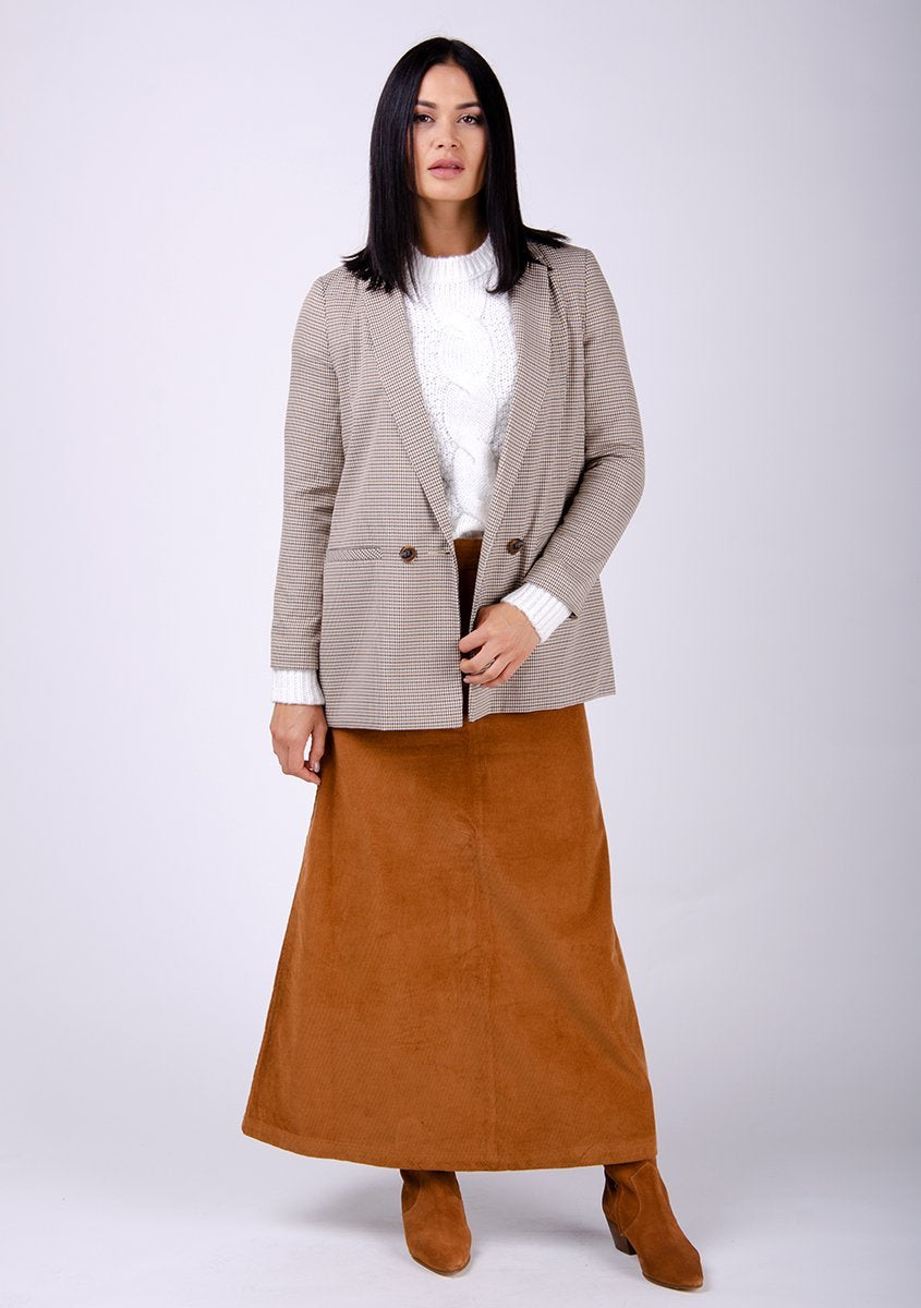 Full-frontal pose showing brown cord skirt silhouette.