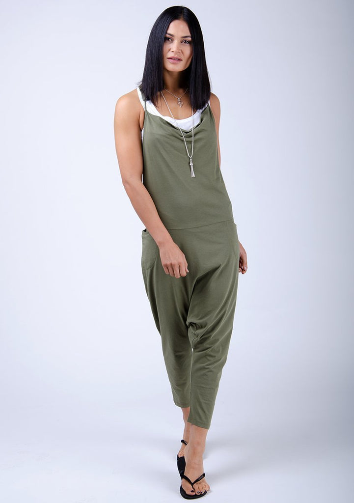 Full frontal motion pose wearing Cindy-style green jersey jumpsuit.